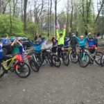 youth-bikes-in-lot-handsup